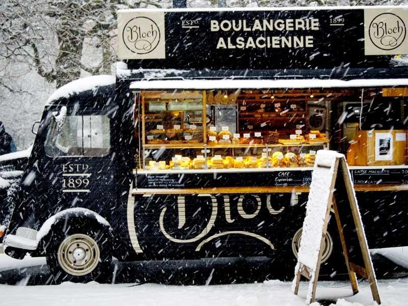 Vintage Renault van turned into a bread van in the snow in Alsace