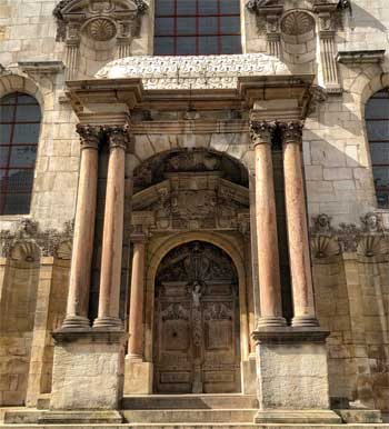 Ancient facade and wooden door of the Law Court, formerly the parliament building, Dijon