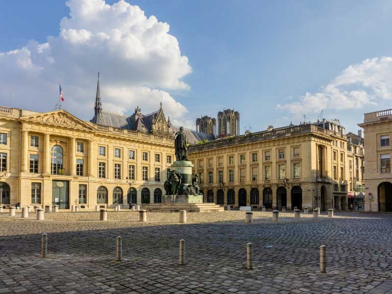 Majestic buildings in Reims city, Champagne and statue of King Louis XV