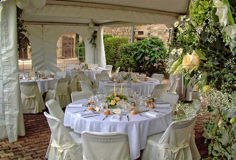 Tables dressed for a wedding in a marquee of a chateau in Dordogne