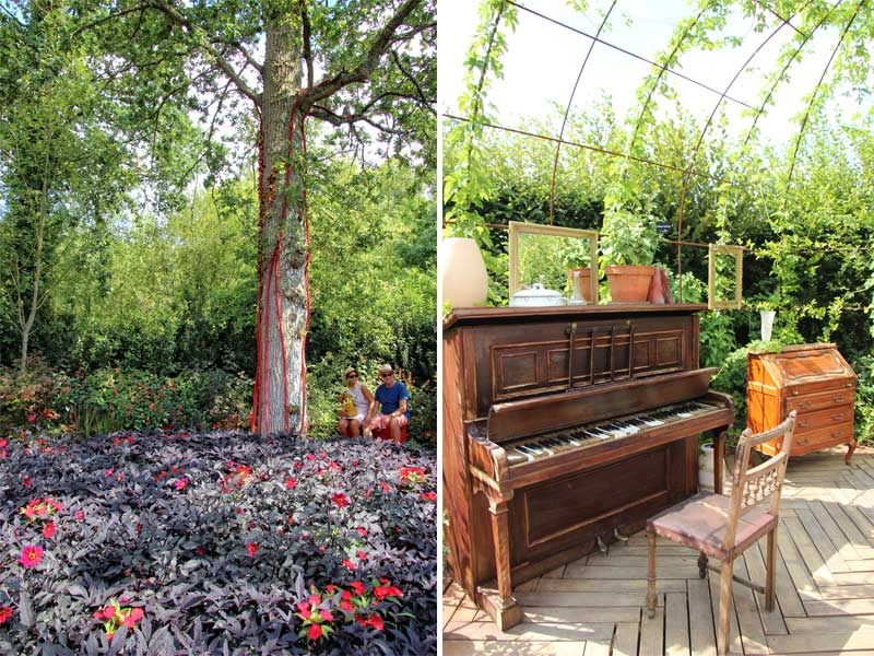 Show garden room with a piano and chair, a wooden bureau and vines growing over a trellis