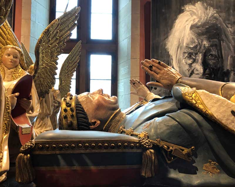 Tomb of Duke John the Good at the Palace of the Dukes, watched over by gold winged angels Dijon
