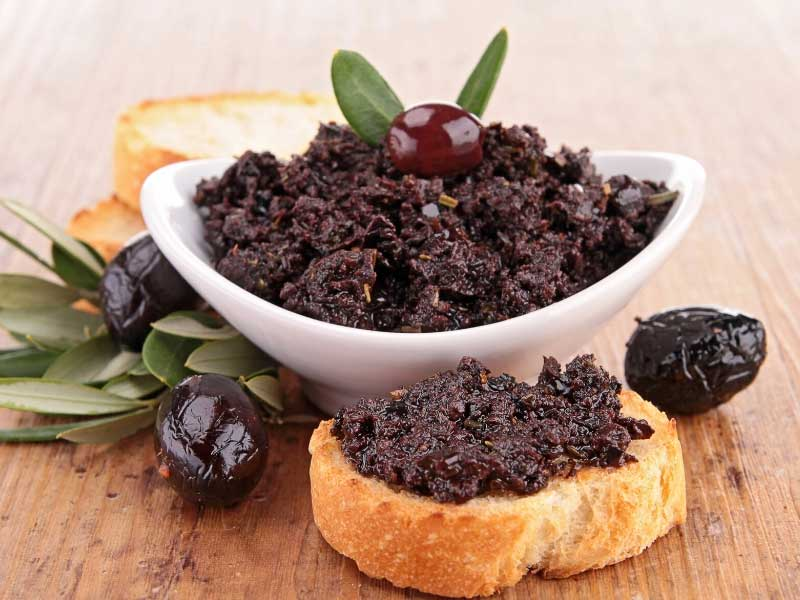 Bowl of tapenade made from crushed olives