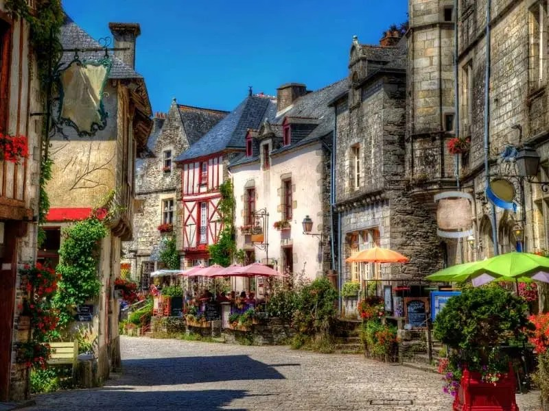 Beautiful half timbered and stone houses and buildings in a cobbled street in Brittany