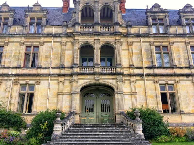 Stunning chateau facade with stone steps leading to a grand door, Loire Valley
