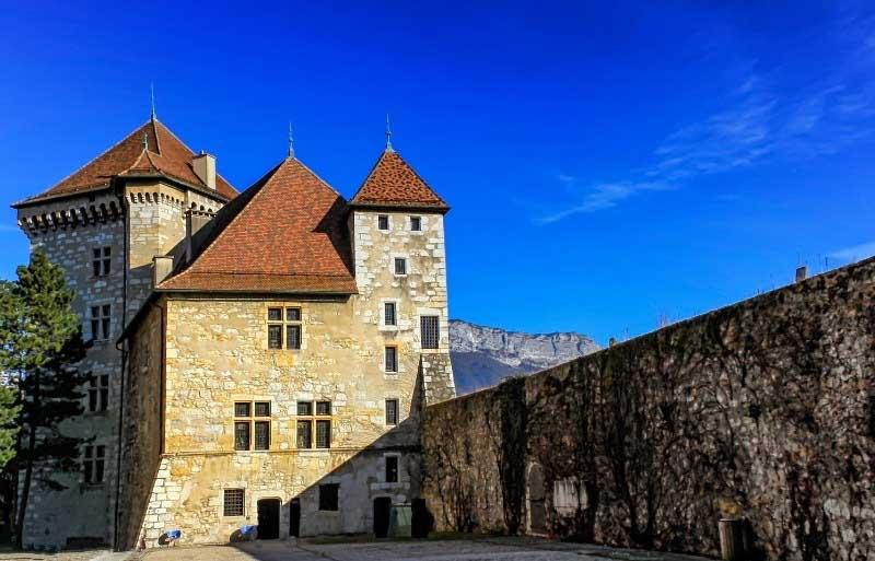 Ancient stone castle under a blue sky