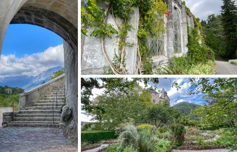 View through an arch in garden of the Chateau de Menthon-Saint-Bernard over the Annecy mountains