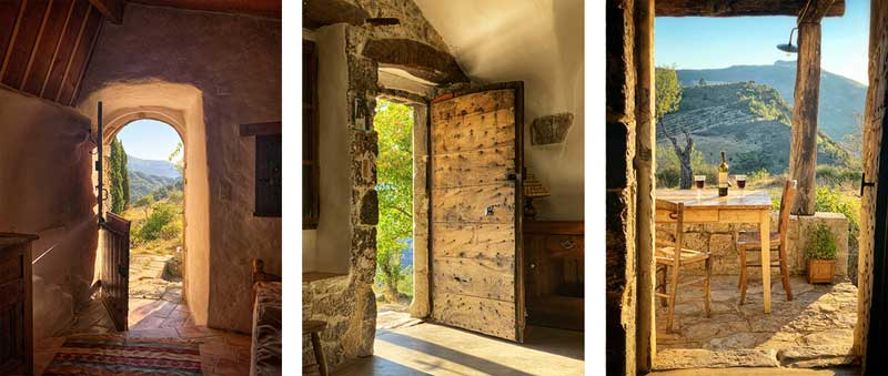 Views through arched doors overlooking Provence countryside and vineyards