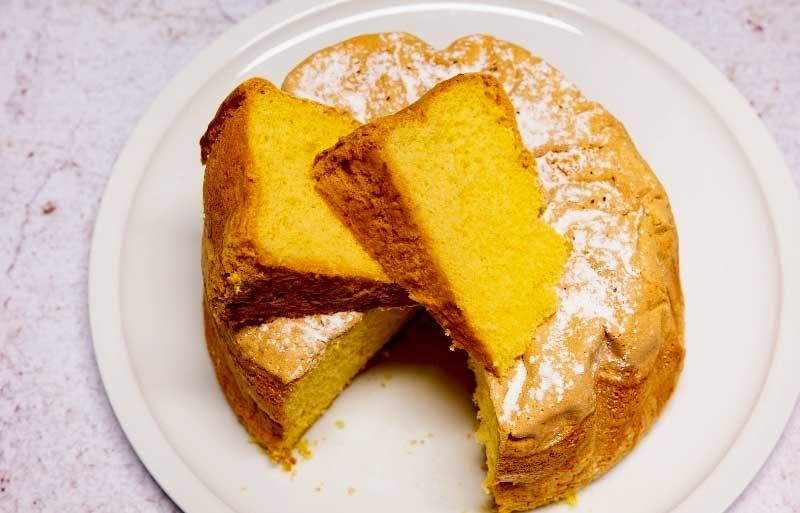 Plate with a gateau de Savoie, sponge cake, cut into slices