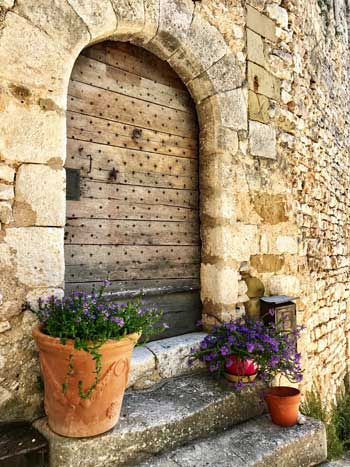 Ancient studded wooden door in Simiane-la-Rotonde, Provence