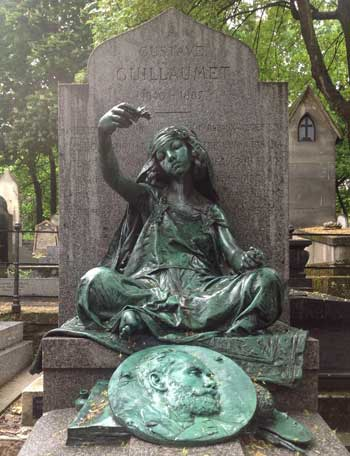 The tomb of Gustave Guillaumet with brass sculpture at Montmartre Cemetery