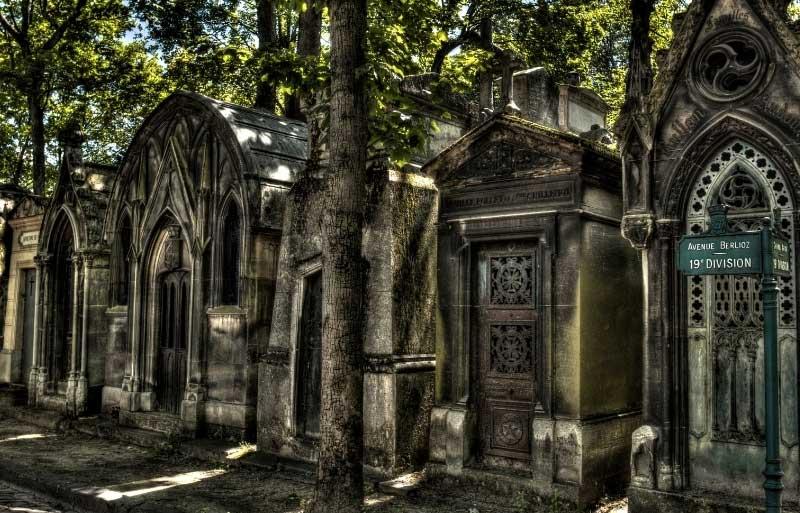 Ancient stone mausoleums at Montmartre Cemetery, Paris