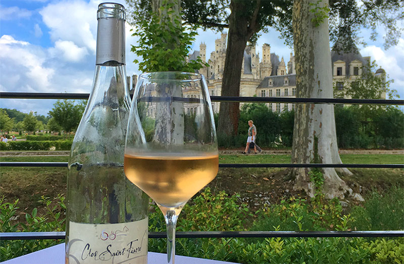 Bottle of wine on a restaurant table, Chateau of Chambord in background