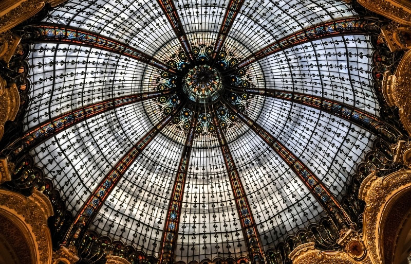 Huge glass dome with art deco patterns at galeries Lafayette Paris