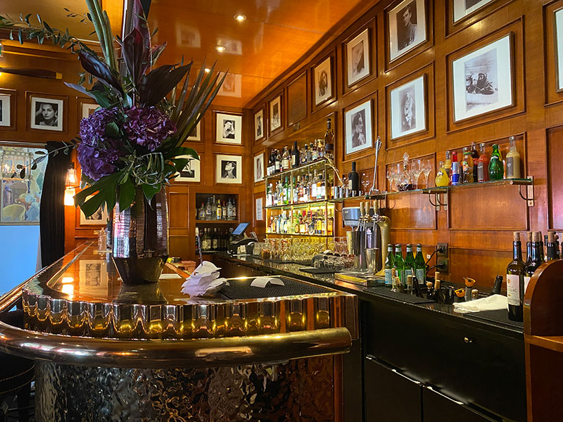 Hammered zinc bar and walls lined with photos at Hotel Fouquet's Paris