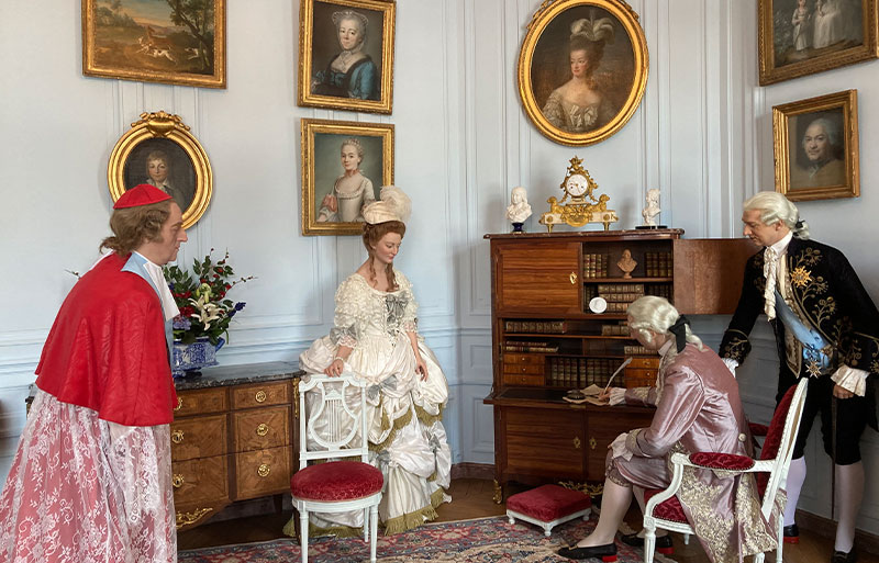 Figures dressed in 18th century costume at Chateau de Breteuil