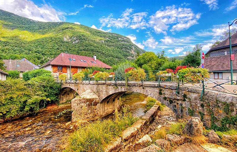 Alpine village of Doussard, a stone bridge over a bubbling stream