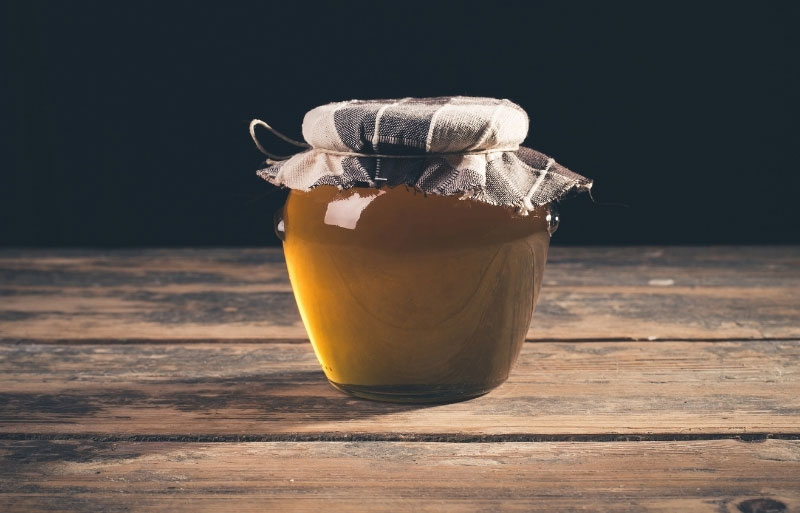 Jar of golden beer jelly