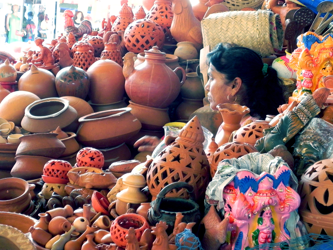 Terracotta shopkeeper in Mapusa - An off-the-beaten-path Goan holiday