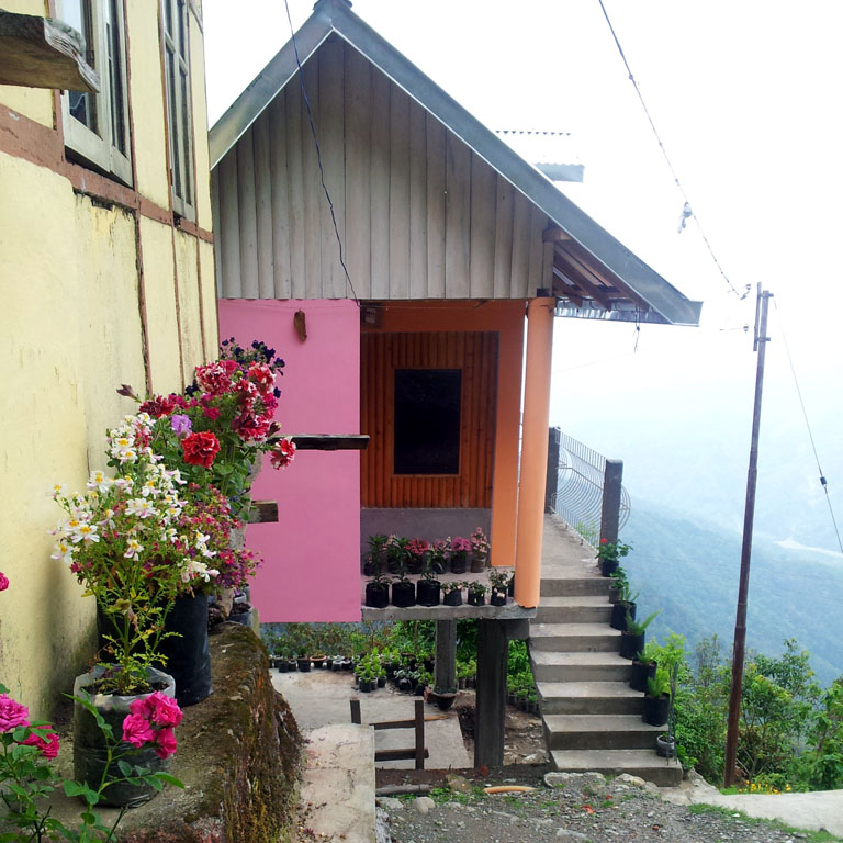 Homestay cottage on the hillside near Kalimpong, West Bengal, India - an escape from the summer heat