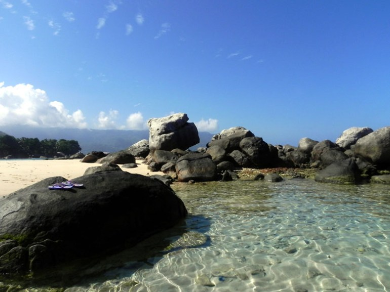 A calm rocky inlet on a beach a few kilometers down from our guesthouse on Mahe