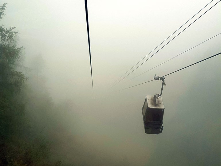 Cable cars in the mist on the Jenner mountain in Bavaria, Germany - travel photos