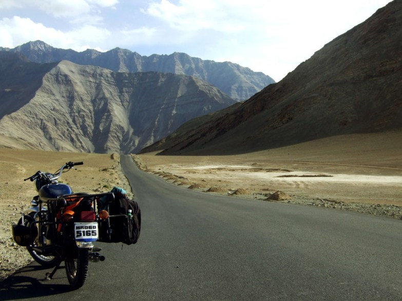 Motorcycle on the highway between Leh and Srinagar in Ladakh, India
