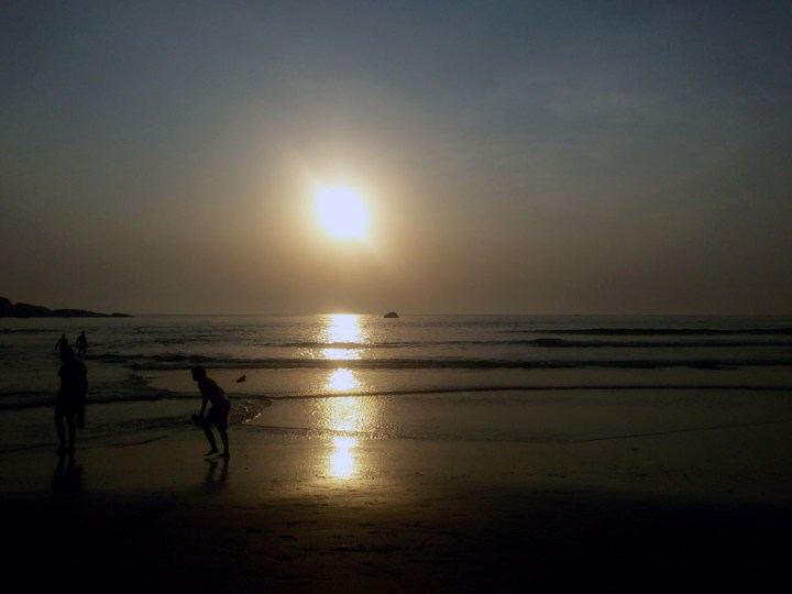 Sunset and tourists on Agonda beach, Goa, India - perfect for a Goa trip