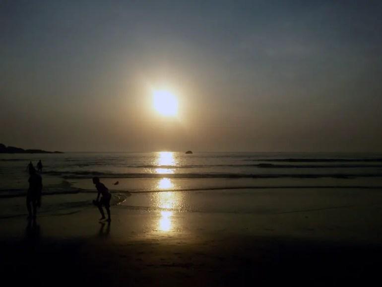 Sunset and tourists on Agonda beach, Goa, India - perfect for a Goa trip