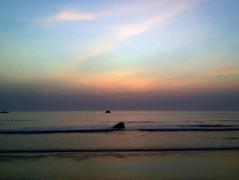 Solitary rocks at sunset on Agonda beach, Goa, India