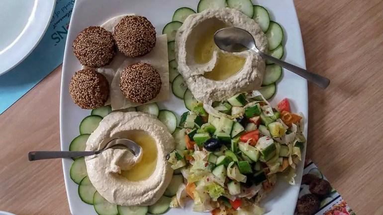 Veg mezze platter at All Seasons, Hyderabad, India. Falafel, pita bread, mouttabel, fattoush, hummus - Great restaurants for vegetarians in Hyderabad
