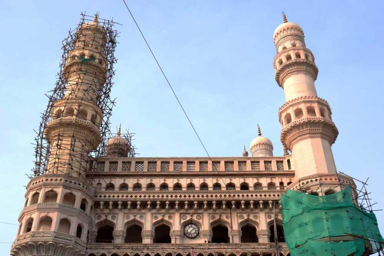 The 56-meter minarets of the Charminar under renovation