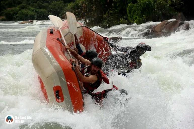 Boat turning over in river rapids, Jinja, Uganda