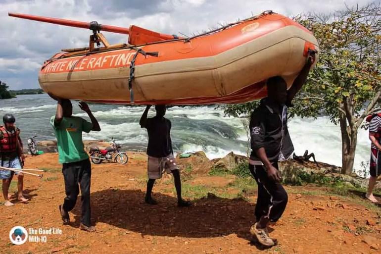 Carrying raft along the river, Jinja, Uganda