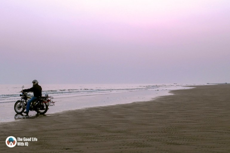 Biker on the beach - Motorcycle touring tips