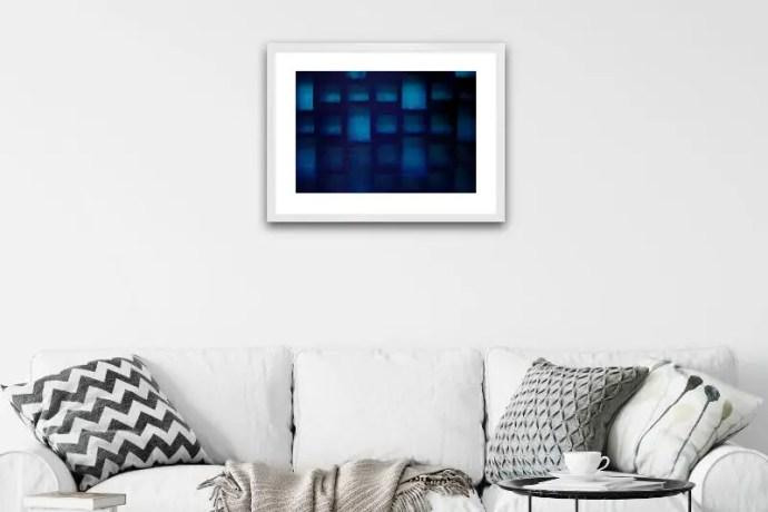 Backlit grid of hollow tiles against textured blue plastic