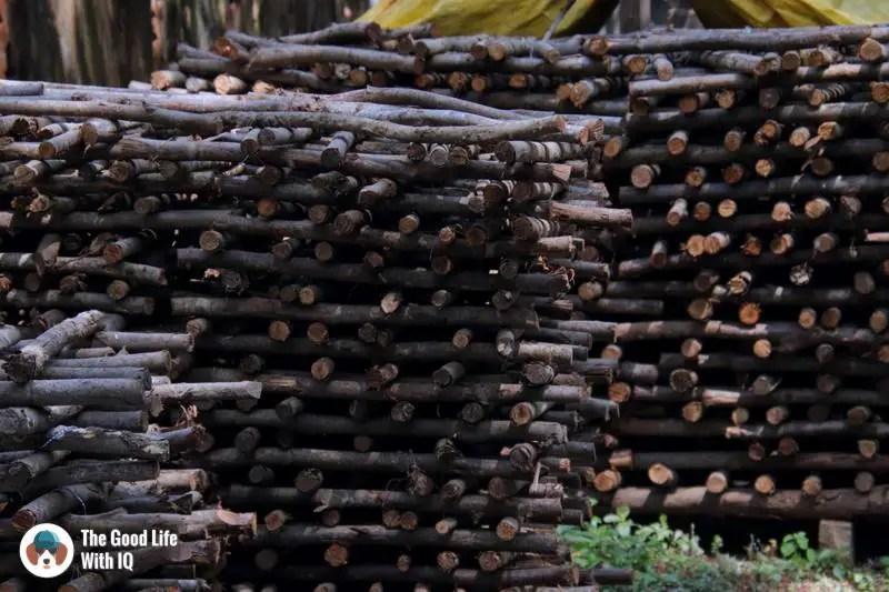 Stacks of wood, Golden Bridge Pottery, Pondicherry