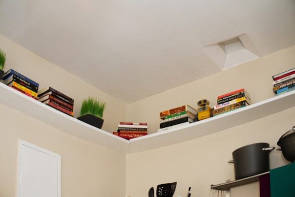 Install shelves along the perimeter of your bedroom walls.