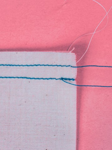 A back stitch shown along side a straight stitch.