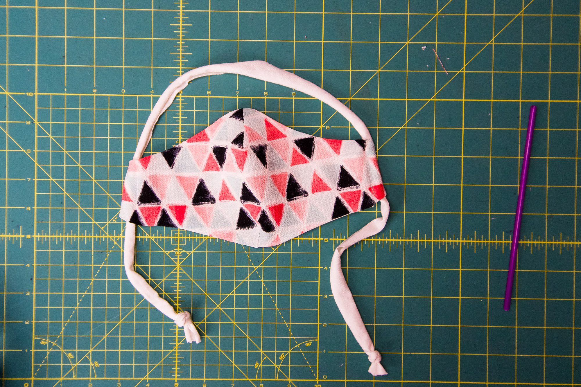 Finished mask on a cutting mat.