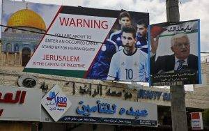 A campaign poster erected in the West Bank town of Hebron, urging Argentina to cancel the friendly match.