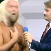 KAYFABE THEATER: The Boogie Woogie Man plants a kiss on Tony Schiavone