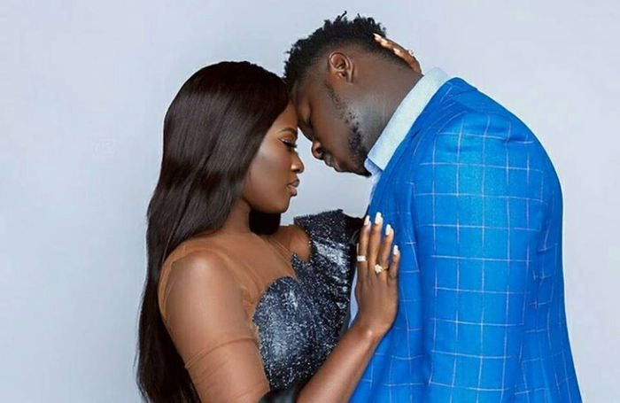Medikal and Fella Makafui chopping love in an elevator