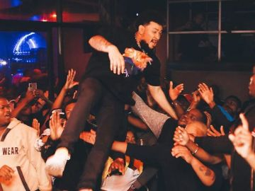 South African Rapper, AKA, Falls Flat On The Floor After Fans Refused To Catch Him In The Air
