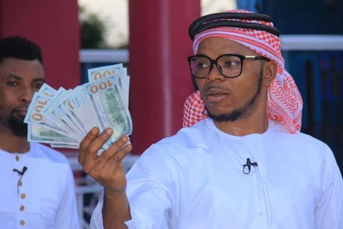 Angel Obinim Flaunts 100 Dollar Bills To Celebrate His Release From Police Custody