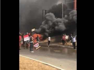 """BREAKING NEWS: """"No Mahama, No Peace"""" - NDC Supporters Burn Tyres And Items At Electoral Commission Headquarters"""