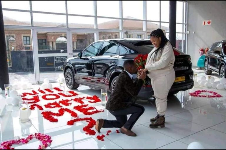 PHOTOS: Ghanaian Man Proposes Marriage To His Girlfriend With A Brand New Porsche Car