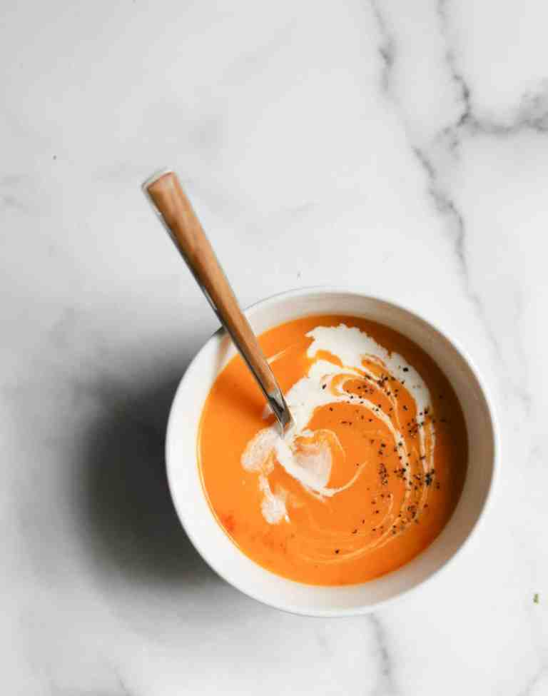 Sweet potato soup in a white bowl