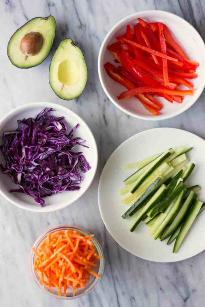 Fresh cut-up vegetables on the topic of creative ways to reduce food waste by finding ways to use up fresh produce.