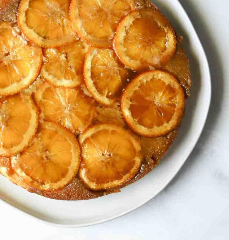 Orange cake on white plate